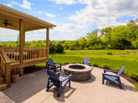This Jones Co. home in Nolensville's Whitney Park neighborhood features a large covered outdoor living area.