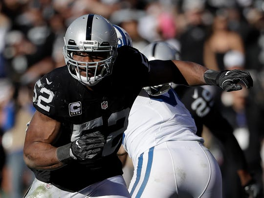 Oakland Raiders defensive end Khalil Mack (52) plays against the Indianapolis Colts during an NFL football game Dec. 24, 2016 in Oakland, Calif.