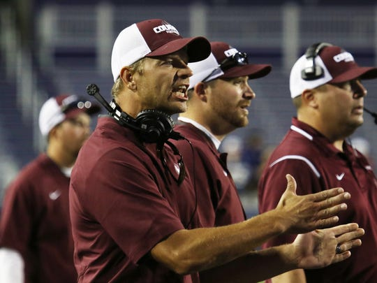 Stuarts Draft head coach Nathan Floyd calls out to
