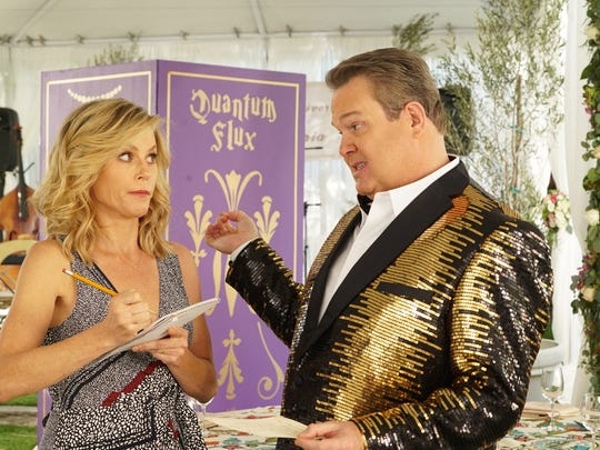 Julie Bowen as Claire and Eric Stonestreet as Cameron on 'Modern Family.'