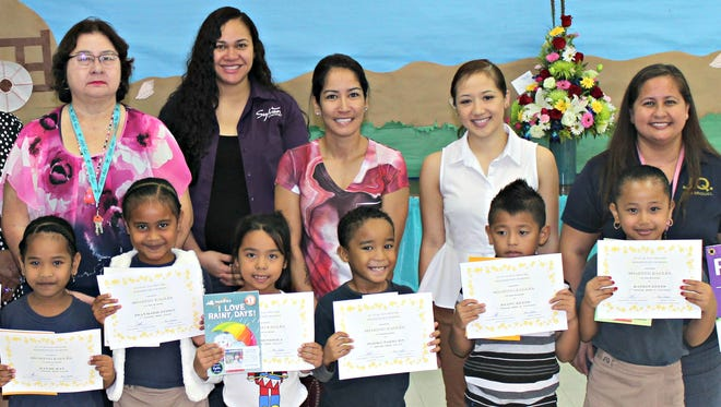 In support of the Positive Behavior Interventions and Supports program, Sylvan donated over 1,000 books to Guam's public elementary schools to promote literacy during January and February 2017. In recognition of their behavioral and academic achievements, Sylvan's Center Director, Crystal Nelson, donated 50 books to the Soaring Eagles of 2nd Quarter during their student of the month award ceremony, January 20. Pictured back row, left: Marissa Castro (Teacher), Monica Borja (parent), Elizabeth Hanzsek (Principal), Marie Caasi (Teacher), Crystal Nelson (Sylvan Learning Center Director), Hilary Frank (parent), Jodee Calvo (teacher), and Pilar Taitano (teacher). Front row left: Jersian Suda, Urijah Sala, Rayme Ray, Praymarie Pedro, T'ani Mendiola, Marko Narruhn, Keanu Reyes, and Katrin Reyes (1st grade student of the month recipients)