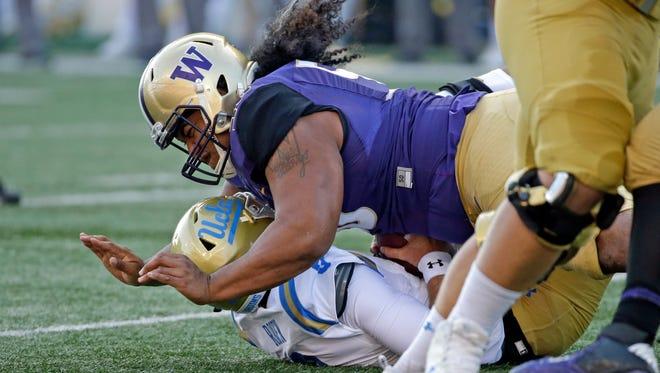 Washington's Vita Vea sacks UCLA quarterback Josh Rosen during a 2017 game.