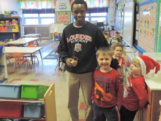 Olivier Ndorimana with his new Cabrini elementary friends.