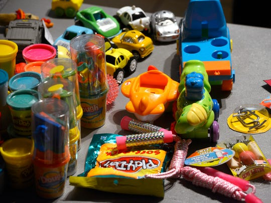 Free toys wait to be given away Saturday during the