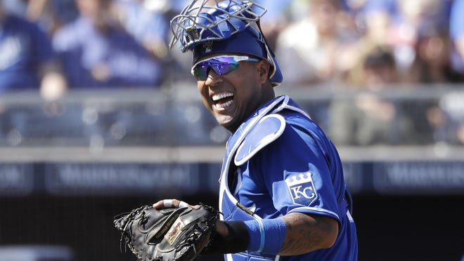 Kansas City Royals catcher Salvador Perez smiles as he turns to a teammate during a spring training game in March in Peoria, Ariz.