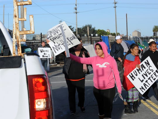 Protesters and Chinatown residents block Soledad Street