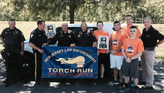 The Somerset County Sheriff's Office took part in the 33rd annual Law Enforcement Torch Run, in support of Special Olympics New Jersey, on June 10. Members of the Sheriff's Office display the Torch Run Special Olympics banner and plaque. Shown are (from left) Sheriff's Officer Dave Daneker, Lt. Mark Szczecina, Sheriff Frank Provenzano, Sheriff's Officer Al Bauer, Sheriff's Officer Dave Syring, Sheriff's Officer Joshua Manzo, Corrections Officer Casey Annuzzi, Sheriff's Cadet Michael DiBella and Col. Richard Borden.