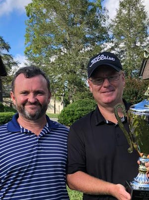 Crooked Creek General Manager Tommy Laughter, left, poses with Apple Jack Amateur Championship Benji McGaha on Sunday.