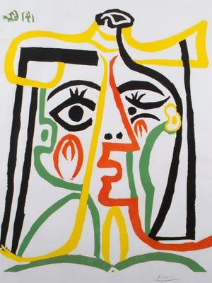 """One of the top lots in the 2015 Larsen Art Auction is """"Portrait de Jacqueline au Chapeau de Paille"""" by Pablo Picasso."""