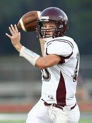 Bronte quarterback Tanner Bedford looks for an open receiver against Irion County during a game last season.