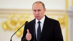 Russian President Vladimir Putin gives a speech during