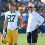 Green Bay Packers general manager Ted Thompson, right, talks with receiver Jordy Nelson during training camp practice at Ray Nitschke Field.