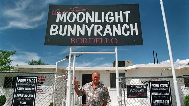 Dennis Hof stands in front of the Moonlite BunnyRanch before building renovations and the change to the spelling of Moonlight in Mound House on Aug. 5, 1999.