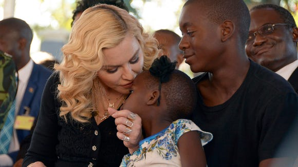 Madonna, kisses one of her adopted daughters Stella,