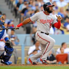 September 1, 2014; Los Angeles, CA, USA; Washington Nationals center fielder Denard Span (2) hits a solo home run in the third inning against the Los Angeles Dodgers at Dodger Stadium. Mandatory Credit: Gary Vasquez-USA TODAY Sports