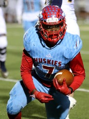 Hirschi's Isaiah White stands up after falling on the
