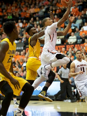 Jan 9, 2016; Corvallis, OR, USA; Oregon State guard Gary Payton II (C) shoots the ball past California forward Jaylen Brown (0) at Gill Coliseum.