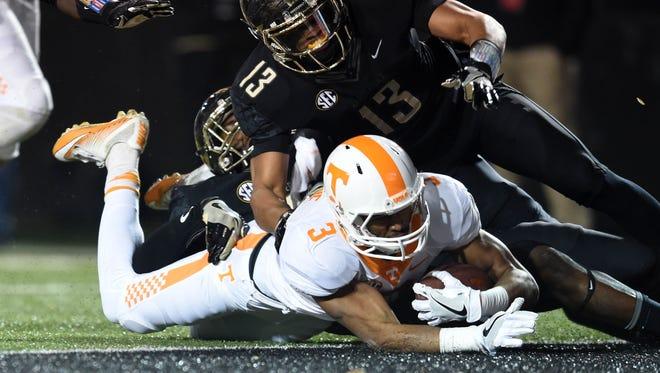 Tennessee wide receiver Josh Malone scores a touchdown despite being defended by Vanderbilt linebacker Zach Cunningham (41) and safety LaDarius Wiley (13) during the first half at Vanderbilt Stadium on Saturday, Nov. 26, 2016.