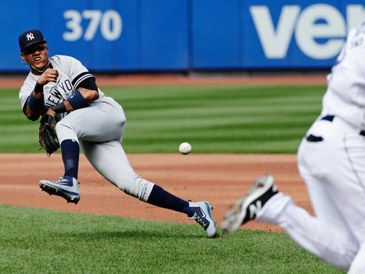 FILE - In this Sept. 13, 2017, file photo, New York Yankees second baseman Starlin Castro is unable to throw out Tampa Bay Rays' Kevin Kiermaier at first base during the first inning of a baseball game in New York.  A person familiar with the negotiations says the New York Yankees and Miami Marlins are working on a trade that would send slugger Giancarlo Stanton to New York and infielder Starlin Castro to Miami.  The person spoke to The Associated Press on condition of anonymity Saturday, Dec. 9, 2017, because no agreement has been completed. (AP Photo/Frank Franklin II, File)