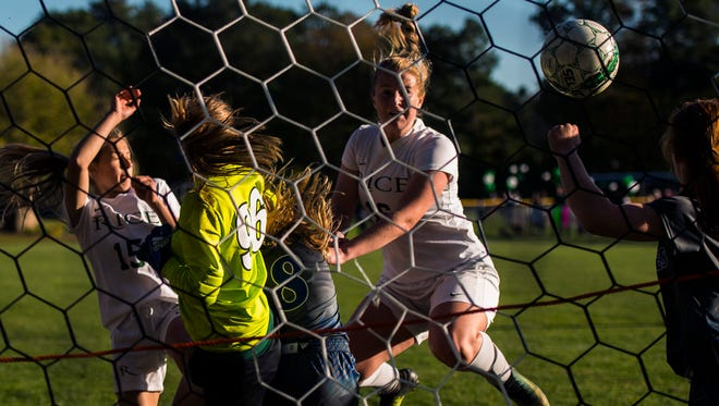 Rice #16 Sarah Boland gets a head on the ball to score against Vergennes during their match up Tuesday, Oct. 17, 2017, at Rice Memorial High School in South Burlington.
