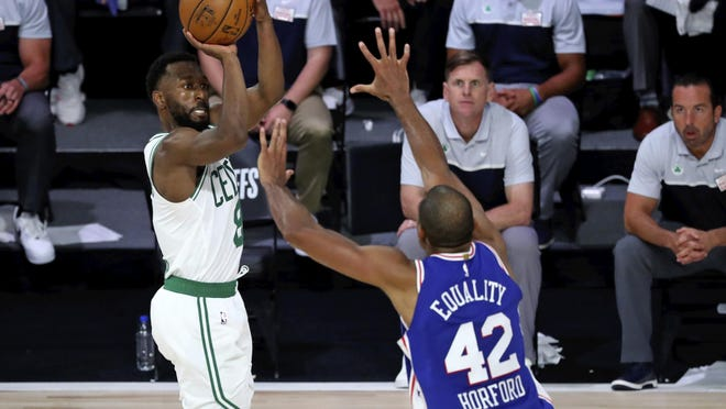 Celtics guard Kemba Walker shoots over 76ers forward Al Horford during the second half in Game 3 of their first-round playoff series, on Friday. Walker led Boston with 24 points.