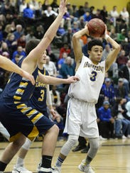 Irondequoit's Robert Diaz-Judson looks to pass during the Class A regional qualifier played at Rush-Henrietta High School on March 7