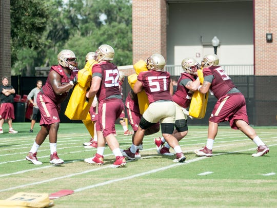 Offensive line in blocking drills as Florida State begins preparations for the 2015 football season with the first day of Fall Camp on Thurs., Aug. 6.