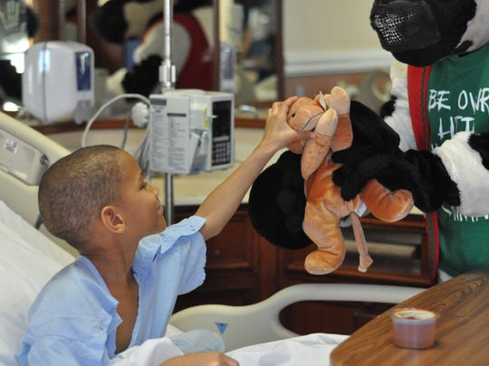 Marcus Simon, 7, was among the pediatric patients at