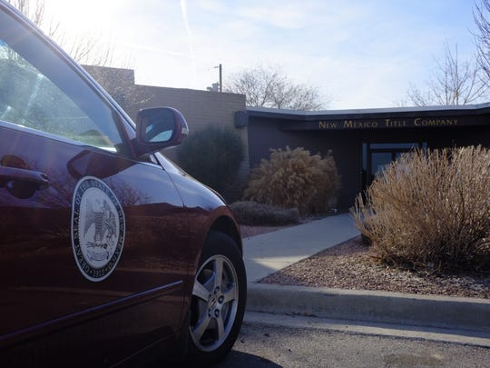 A State of New Mexico vehicle is seen parked, in a file photo from Feb. 7, 2012  at New Mexico Title Company in Farmington.