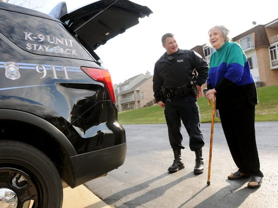 Officer Chad Smith shows Dorothea Knight the new vehcile that was bought with funds she donated Wednesday, April 13, at her home in St. Clair Township.