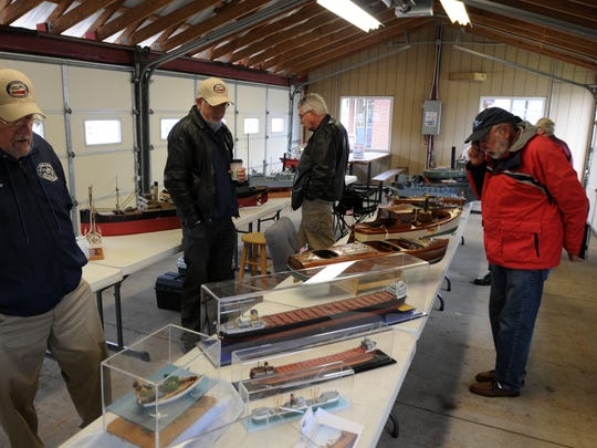 Members of the Great Lakes Nautical Society display and check out model boats Sunday, May 15, at the St. Clair Boat Harbor.