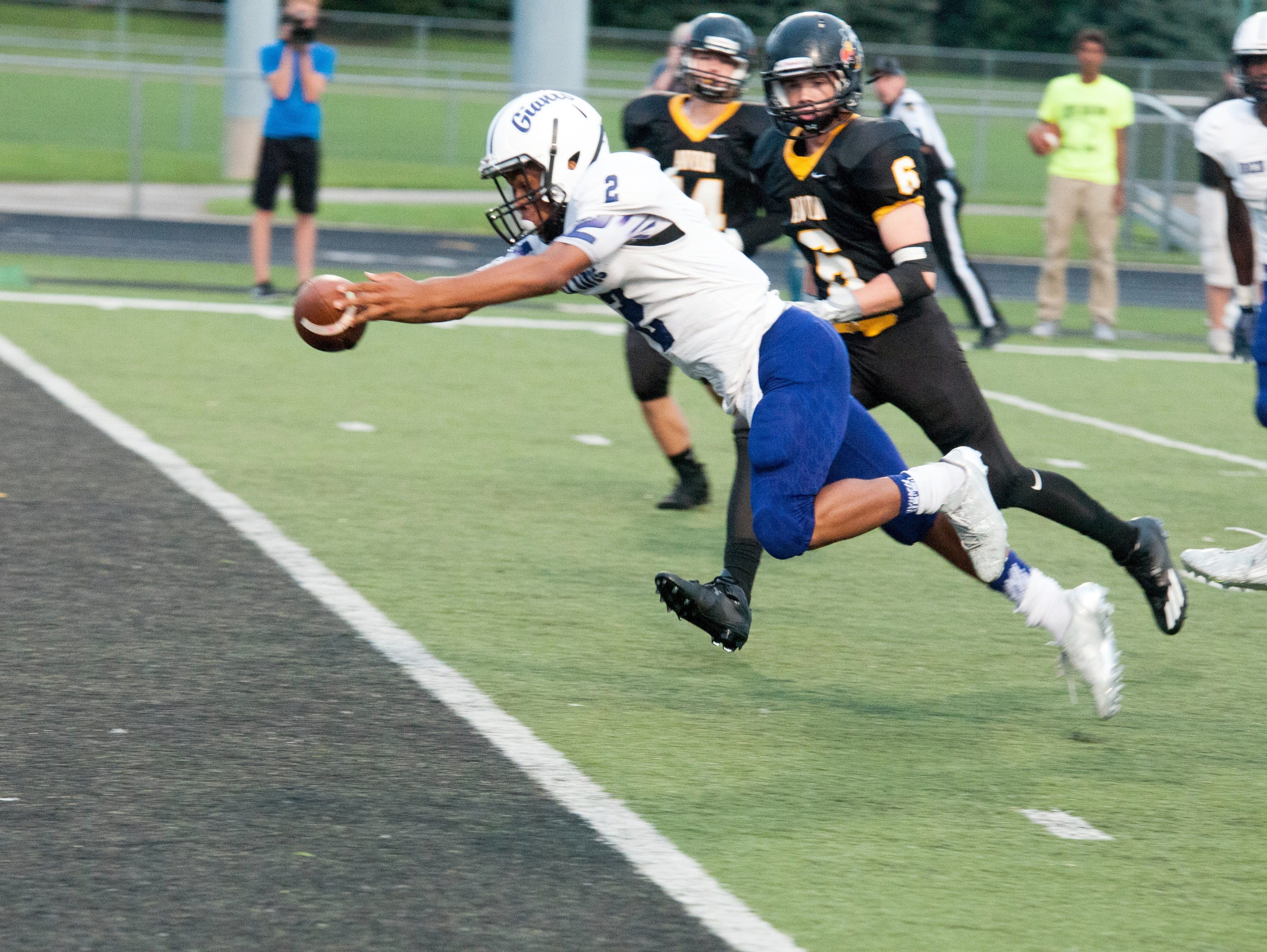 Ben Davis' Reese Taylor reaches out for the goal line in the Giants' lopsided win over Avon Friday night.