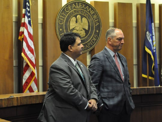 Jimmy Sawtelle (left), chancellor of Central Louisiana Technical Community College, and Gov. John Bel Edwards listen during a news conference in Alexandria City Hall about CLTCC relocating its Alexandria campus downtown.