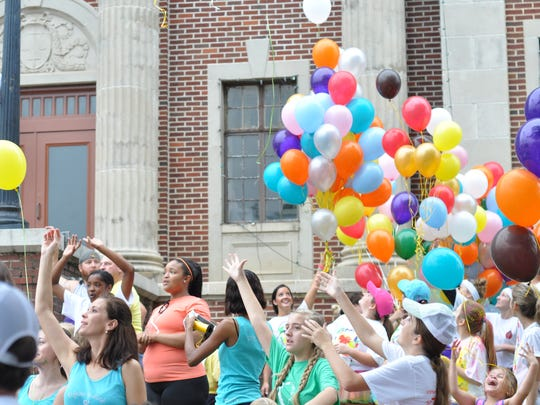 Balloons are released Saturday morning before the STEPSCenla Color Run.