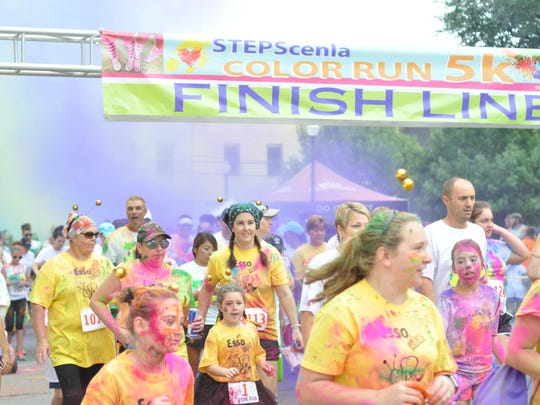 STEPSCenla Color Run participants begin the race Saturday morning.