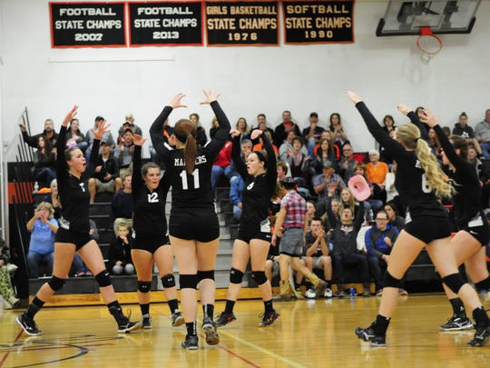 Marine City celebrates a point against Lakeview on Oct. 13, 2016.