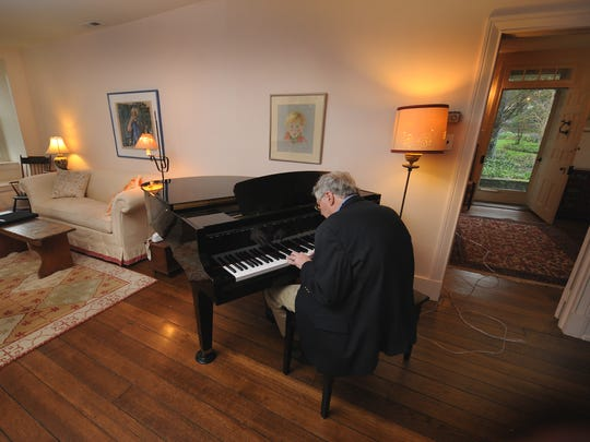 Musician and attorney Jeff Bove performs in his home in 2010 with his oxygen tube snaking into another room where his oxygen tank stood. After suffering from idiopathic pulmonary fibrosis, he had a double lung transplant three months after the photo was taken, saving his life.