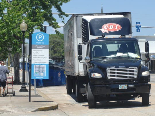 A driver walks back to his oversized vehicle on Jefferson Street in downtown Pensacola on Friday, April 21, 2017. Controversy has arisen over the Pensacola Downtown Improvement Board's agreement with Vinyl Music Hall over the venue's command of public parking.