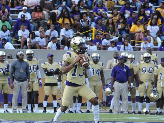 Alcorn State quarterback Noah Johnson reads the defense as Alcorn State beats Alabama A&M.