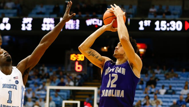 Marc Gosselin (12) hit a clutch 3-pointer to lift Western Carolina over Mercer on Wednesday night.