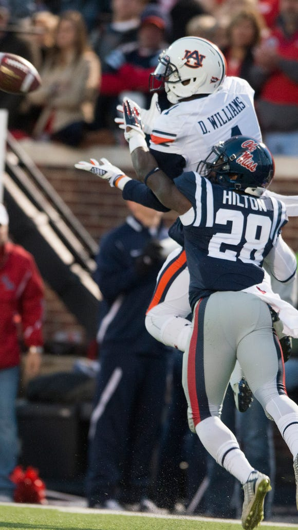 Auburn wide receiver D'haquille Williams (1) catches a pass as Mississippi defensive back Mike Hilton (28) during the NCAA football game between Auburn and Mississippi at University of Mississippi in Oxford, Miss., on Saturday, Nov. 1, 2014.