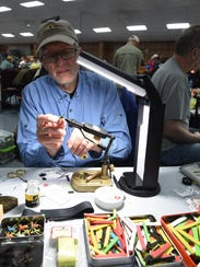 Jack Harford of Indianapolis uses a piece of hobby