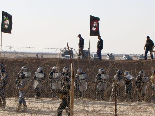AP_IRAQ_CAMP_ASHRAF_46005517