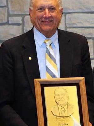 Randy Iceman displays his NOPGA Hall of Fame plaque.