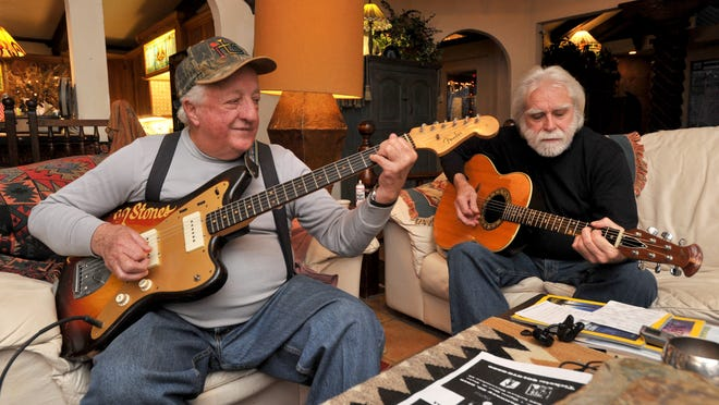 Two members of the Original Rolling Stones, Joe Tubb (left) and Andy Anderson, practice at Anderson's home in Clinton for their upcoming performance Thursday at the Old Capitol Museum in Jackson.