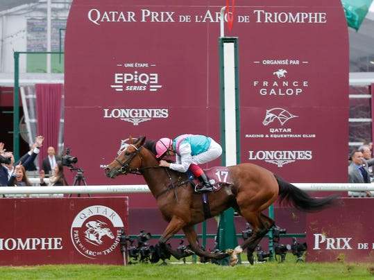 Italian Lanfranco Dettori riding British horse Enable crosses the finish line to win the Qatar Prix de l'Arc de Triomphe horse race at the Chantilly horse racetrack, 40 kms(25 miles) north of Paris, France, Sunday, Oct. 1, 2017. (AP Photo/Michel Euler)