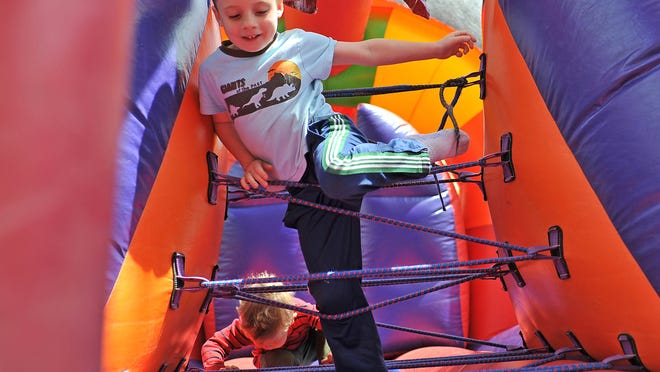 Ayden Black, 6, of Vineland enjoys going through an obstacle course at the parish festival on Sunday. See photo gallery at www.thedailyjournal.com/photos.