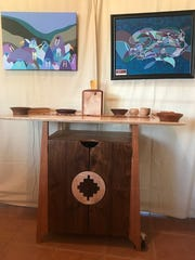 This table by Steven Barr and paintings by Timithy