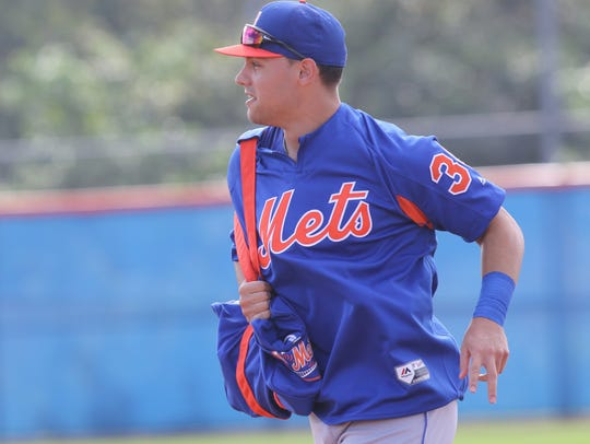 The Mets workout this morning.  Michael Conforto runs