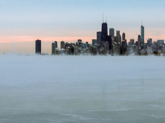 Steam rises over Lake Michigan near the Chicago skyline